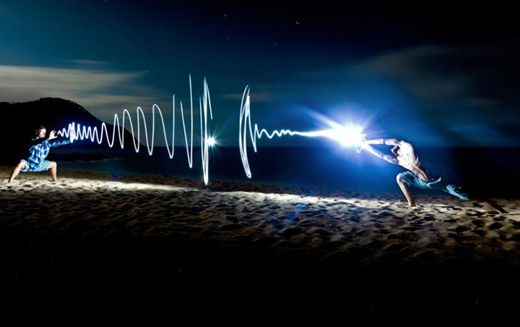 Light Painting...PIC BY REGIS MATTHEY / CATERS NEWS - (PICTURED Light painting of two men fighting on a beach in New Zealand) A photographer has brought a series of pictures taken in the middle of the night to life - by using spectacular light paintings to outline imaginary people. In one scene an empty playground becomes filled with excitable children and in another a basketball court is lit up with a player preparing to take aim. Swiss photographer Regis Matthey, 25, creates his art using a long exposure shot meaning he only has several seconds to draw the paintings before the camera shutter closes. And despite his stunning results Regis, who captured the images at various locations near the Swiss town of La Vallee de Joux, insists you only need basic equipment to create such work. SEE CATERS COPY